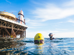Swimmers near the end of Brighton Pier