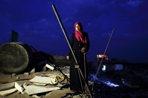 Eman Al-Najar, 23, saw her home in Khoza'a in Khan Yunis destroyed and her brother killed by Israel Defense Forces during the summer's 50-day war between Israel and Hamas. She still stays in a tent with her family on the site of this damaged home. Despite the difficulty, she cannot leave, since there is no other place to move, or too expensive. And virtually nobody has come to help yet.