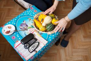 Ornamental pumpkins remote controls and sausage.
