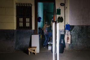 A a man posing at a shop in Havana, Cuba