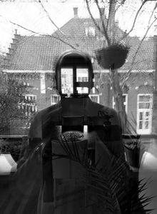 Selfie (looking out my window)