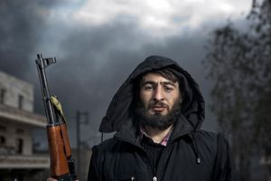 A Free Syrian Army (FSA) member stands for a portrait near the site of a government artillery strike in the Sakhour district of Aleppo on February 7, 2013.  © Nish Nalbandian