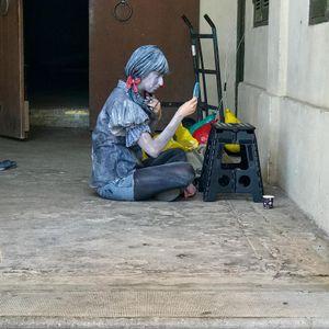 Tel Aviv street performer getting ready