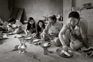Ratna and family eating in traditional style