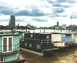 Houseboats And Thames Towers