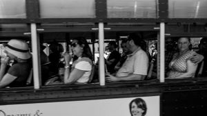 Passengers on a trolley. French Quarter Festival.  New Orleans.
