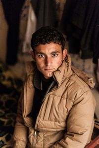 08/02/15 -- Sulaimaniyah, Iraq -- Khaled, 16, from Shingal, lives at the Baghdad Hotel with his brother Utto who is 32. Together they sell cigarettes to pay the rent.