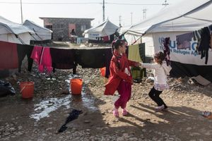 17/01/2015 -- Kirkuk, Iraq -- Noor and her friend play in the camp. Noor Zuher is 11 years old, from Sador village in Diyala. On September 20th war planes started bombing people escaping their villages in the province of Diyala, on the way to Qaratapa: Noor lost her mother and 2 brothers, and on the same day the Shiea militia took her father. She now lives with her grandfather in the Laylan IDP ca