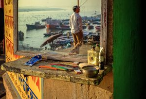 Life in Varanasi starts with the sun illuminating the banks of the river, lightning up the colours in very intense way. The locals start their everyday activities immediately after the bath in Ganga, just like this street barber shop.