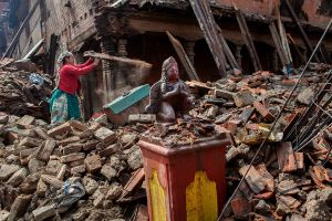 An undamaged statue of Hindu Goddesses in front of a broken temple at Bhaktapur, Nepal, 09 May 2015.