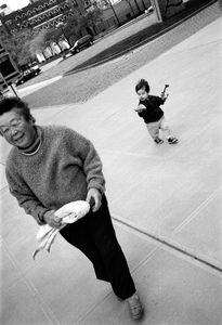 Noah  Drysdale (18 months) walks with his grandmother at NYU.  Ethnicity:  Japanese • Scottish ©2014, Stephen Shames