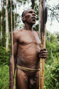 Korrowai bushman whistling: South-eastern Papuan jungle.