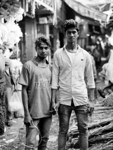 Brothers Saddam and Najir asked me to take their portrait in Kolkata's flower market where they work , clasping each other's hands when they posed for me. Kolkata 2017