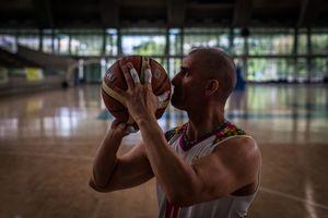 Oscar Rios, 42, prepares to throws the ball to the basket during the training warm-up session of Antioquia's team at Atanasio Girardot Stadium, Medellin, March 2016.