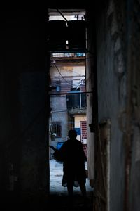A woman standing in a hall way in Old Havana, Cuba