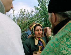 "Palm Sunday at the Russian Orthodox Church. Yampil, Ukraine, 2005. From the series ""From the Mountains and to the Sea"" © Nadia Sablin"