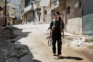 A YPG fighter walks down the street in Sheikh Maqsood, Aleppo on April 20, 2013. © Nish Nalbandian
