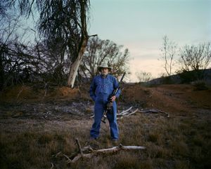 baboon hunter # II, at dusk eastern cape south africa-from the series 'hunters'-David Chancellor