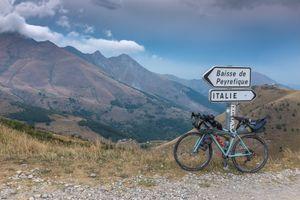Crossing the French-Italian border on a gravel track over the Col de Tende (Colle di Tenda)