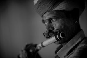 Turban, mustaches and flute