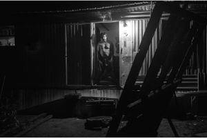 Chico stands in the doorway of his trailer.