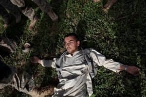 A young Afghan man is searched and questioned by U.S. Army soldiers from the 10th Mountain Division in the Tangi Valley, Wardak Province, Afghanistan on September 8, 2009. © Adam Ferguson