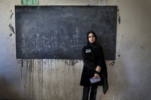 Asila, 18, is an election worker at a voting centre in Kabul on August 20, 2009. Contenders in the race to become Afghanistan's next president claimed to be heading for victory in polls acclaimed by the West but were then undermined by complaints of ballot-stuffing and low turnout. © Michael Christopher Brown