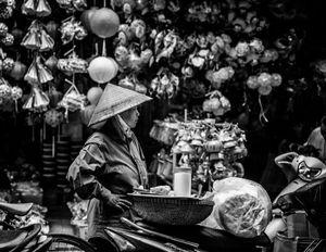 Comtemplation, street life Hanoi Vietnam