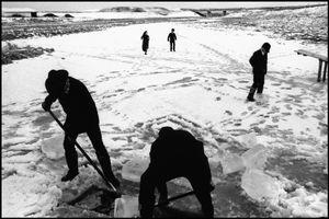 © George Webber - Men breaking ice, 2000