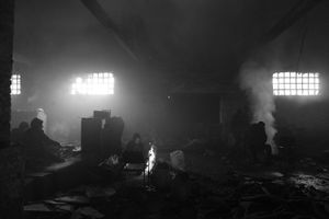 Scenery inside the abandoned train depot where people sleep, cook, eat and spend their daily life.