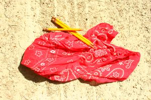 red bandana with three yellow hand sharpened pencils