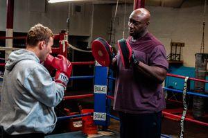 Actor/director Kent Moran & actor Michael Clarke Duncan, train in the ring.