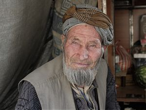 The social norm of respecting the elders can be seen through the smiles of the man