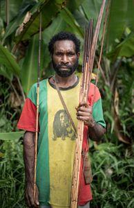 The hunter: Ikeres, father of Petrus. Sonamburu village, Papua