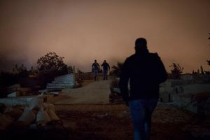 Palestinians snick into a cemetery in East Jerusalem to attend the funeral of Mu'taz Hijazi, a Palestinian who ran-over Israelis in a Tram-Station in Jerusalem and was shot by the police, 2014.
