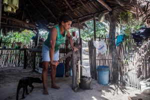 Aurideia Brito pumps water to prepare breakfast in her house in Queimada dos Britos. Even during the harsh summers they can access water making it possible to live surrounded by desert. © Eduardo Leal/4SEE