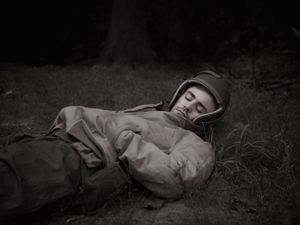 Tank driver, Simon Odell, on the front in Europe, rests during a lull in the fighting | Laurence, 1944