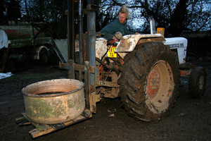 Moving the vat of apple juice with the help of a tractor