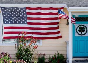 Small house, big flag