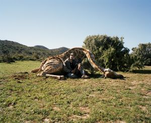 hunter with giraffe, ladysmith, south africa-from the series 'hunters'-David Chancellor
