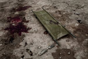 A stretcher and blood stain remain on the ground after an ISAF convoy consisting of Italian military vehicles was targeted in a car bomb attack in Kabul, Afghanistan, on Thursday, September 17, 2009. Six Italian soldiers and an estimated ten civilians were killed in a car bomb attack on the ISAF military convoy. © Adam Ferguson
