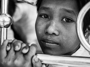 Girl in a Burmese pick-up schoolbus.