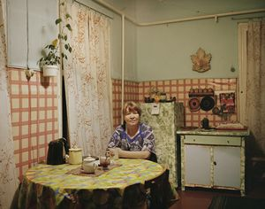 Luba sits in her kitchen. Port Baikal. Eastern Siberia, November 2004 From the book, Motherland, by Simon Roberts © Simon Roberts