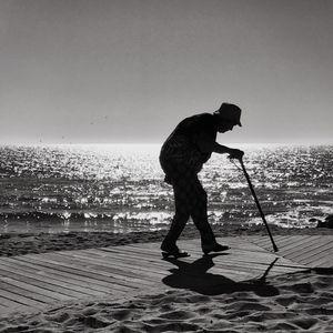 Hunchback woman walking