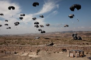 U.S. Army supplies are dropped by parachute at Combat Operations Post Margah, the outpost of the 172nd Infantry Brigade, U.S. Army in Paktika Province, Afghanistan on September 7, 2011. © Adam Ferguson