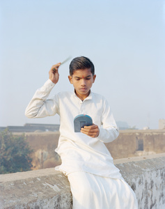 "Rama combing his hair, Ayodhya, 2015. From the series ""A Myth of Two Souls, Chapter 1: Early Time"" © Vasantha Yogananthan, Prix Levallois 2016"