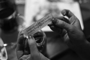 © Nafise Motlaq - Kosar reads her daily 'fortune cookie'.