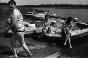 A mother and her two daughters, resting on the bank of the river, swimming and taking alcohol. Nelmach. Tomsk region. Russia. 2008.