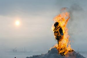 For the holiday of Shrovetide, the Russian tradition is to burn a scarecrow. This represents the passing of winter and the beginning of spring. In Norilsk, the winter lasts 9 months, so this tradition offers only the distant hope of sun and warmer weather. The people must wait another 2-3 months before the arrival of true spring. © Elena Chernyshova
