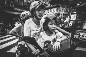 Child sitting on the motorcycle